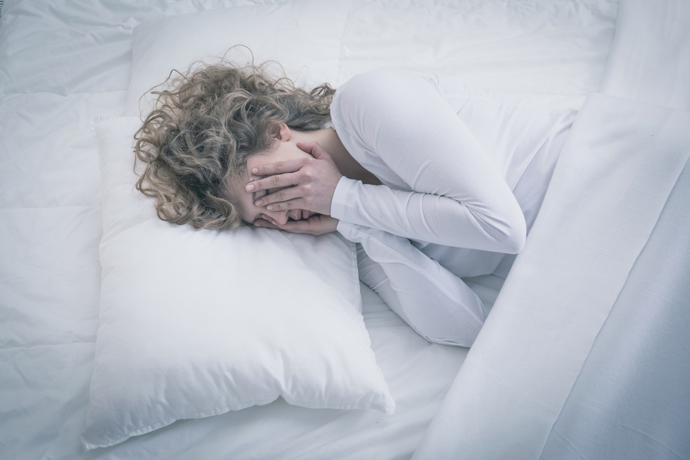 woman in bed crying