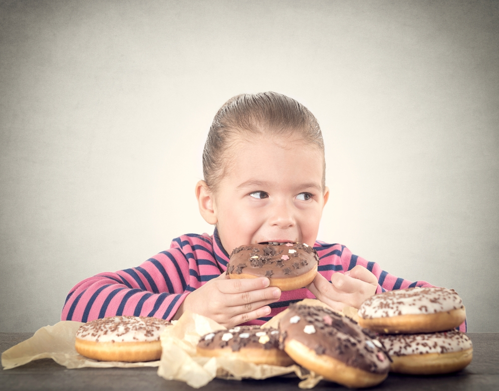 toddler and donuts