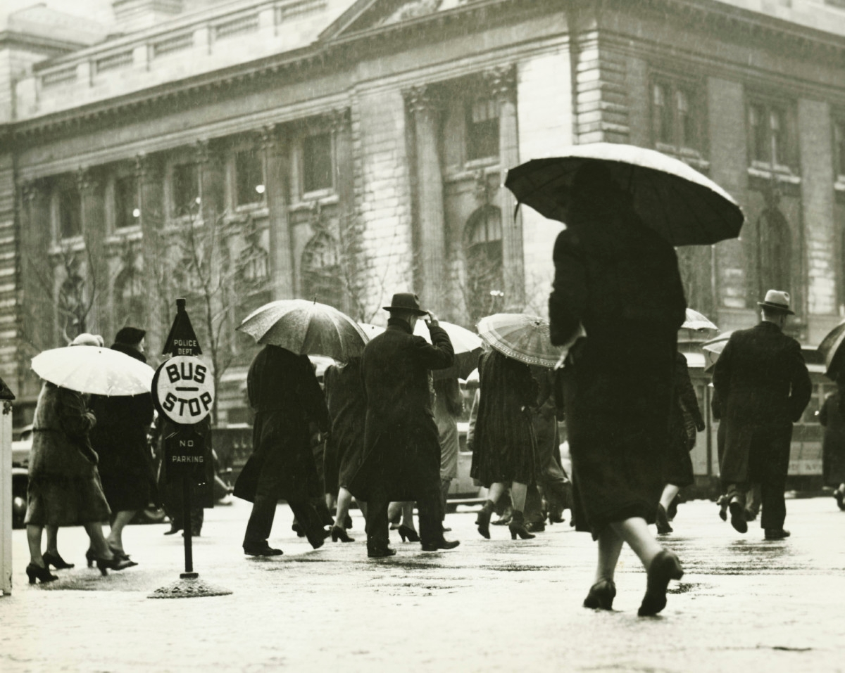 Pedestrians walking in rain in New York City,