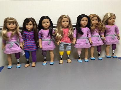 doll with prosthetic leg