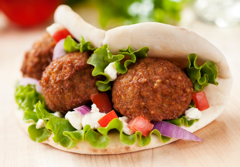 """""""Falafel wrap with onion, feta, tomato, and lettuce. Please see my portfolio for other food related images."""""""