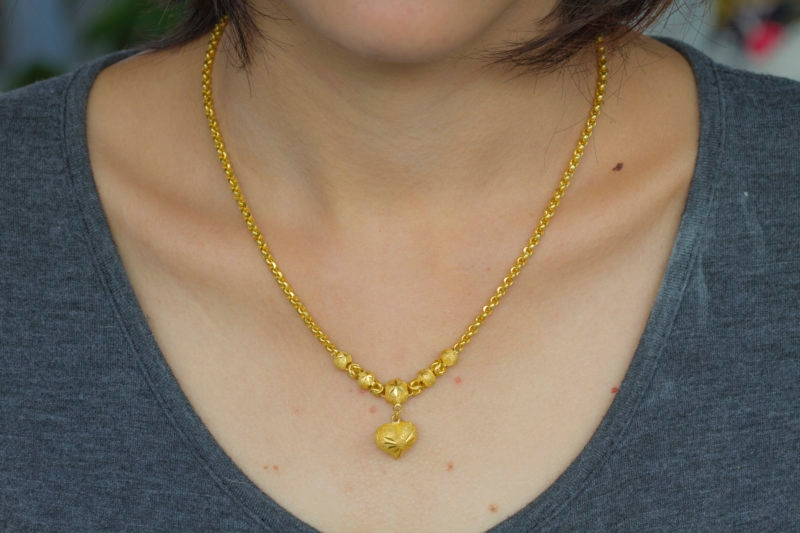 close up Young Woman Wearing Golden Necklace