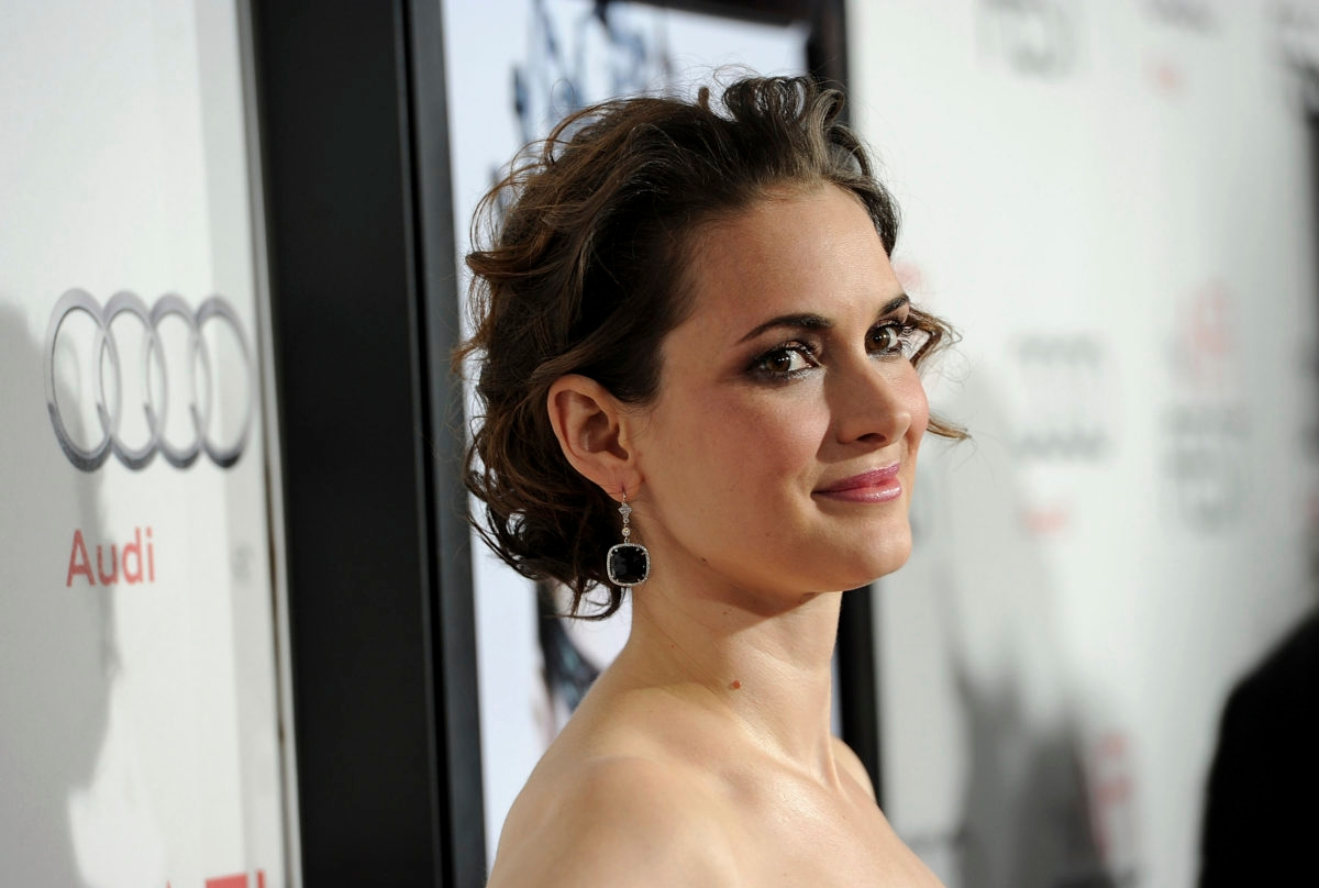 """HOLLYWOOD - NOVEMBER 11: Actress Winona Ryder arrives at the """"Black Swan"""" closing night gala during AFI FEST 2010 presented by Audi held at Grauman's Chinese Theatre on November 11, 2010 in Hollywood, California. (Photo by Alberto E. Rodriguez/Getty Images for AFI)"""