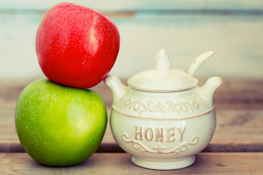 Jewish new year composition of an apple and honey