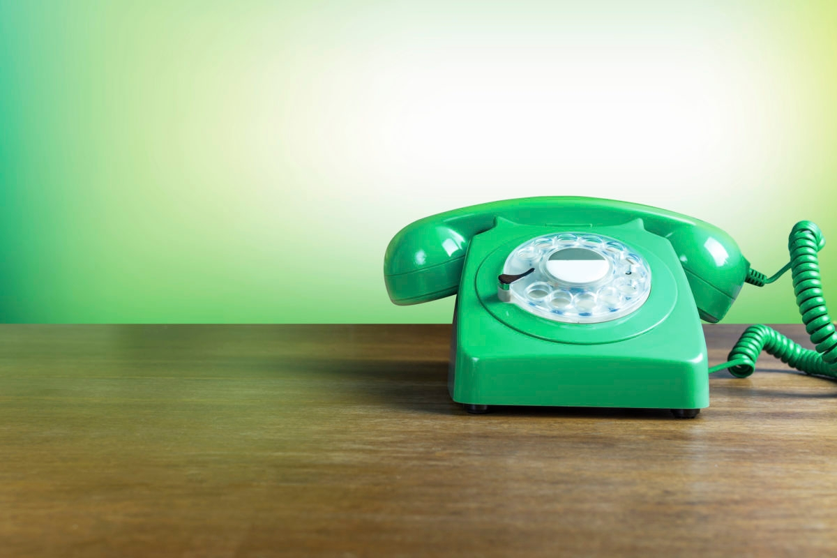 Vintage Green Phone on a Wooden Background