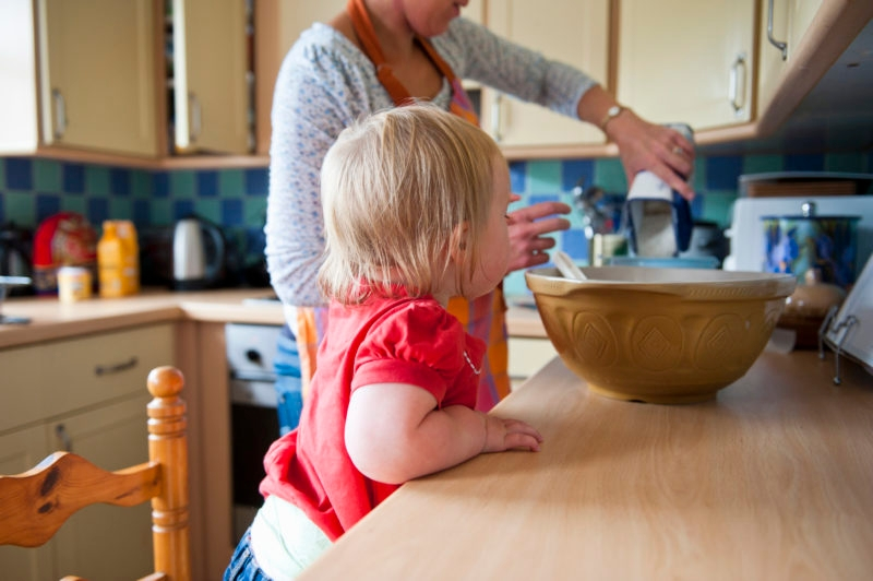 Toddler girl baking with mother