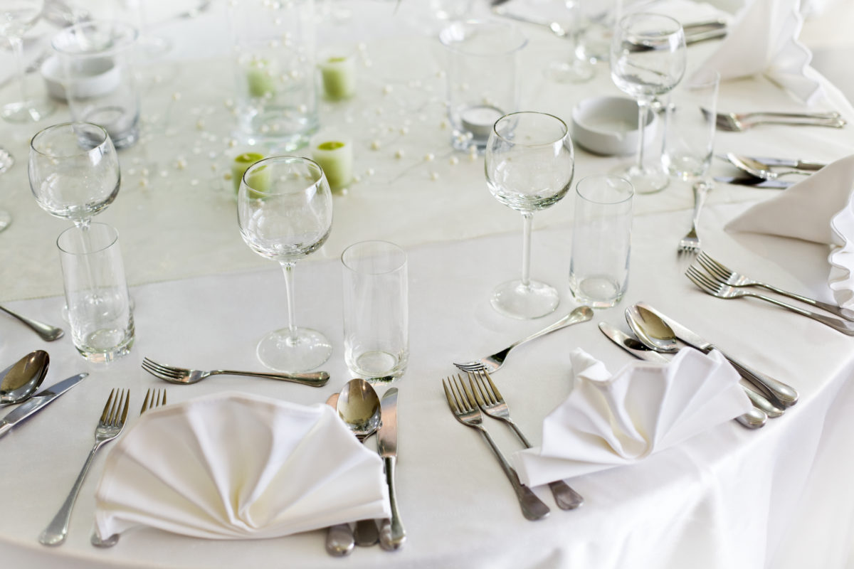 Wedding reception table set awaiting guests and food.
