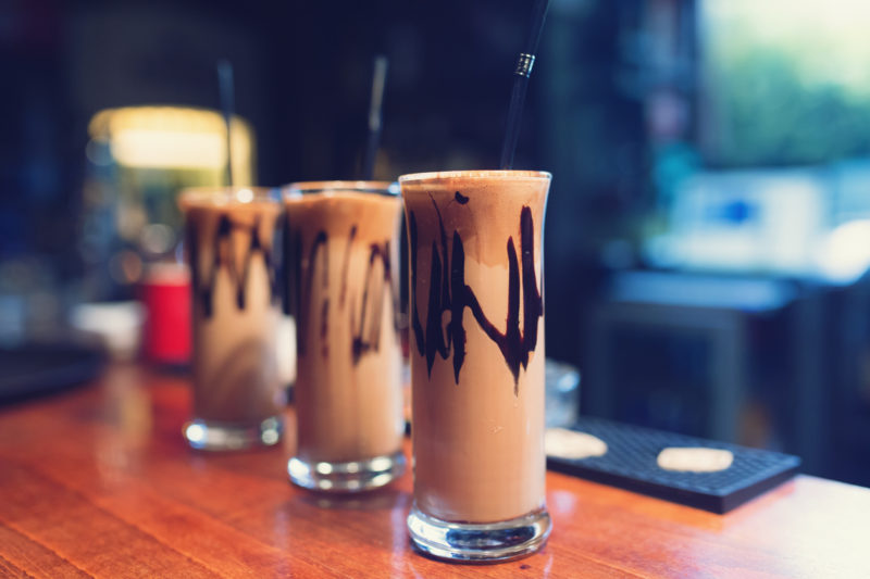 Close-up shot of fredo coffee on a bar counter.
