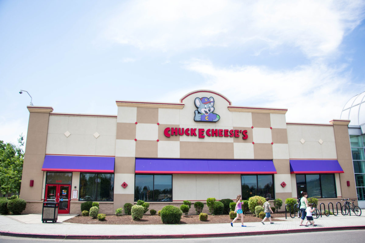 Eugene, Oregon, USA - July 8, 2014: Chuck E Cheese restaurant location in Eugene, Oregon. Chuck E Cheese is a family oriented restaurant primarily focusing on children with arcades, rides, and a prime spot for birthday parties across the United States with more than 500 locations.