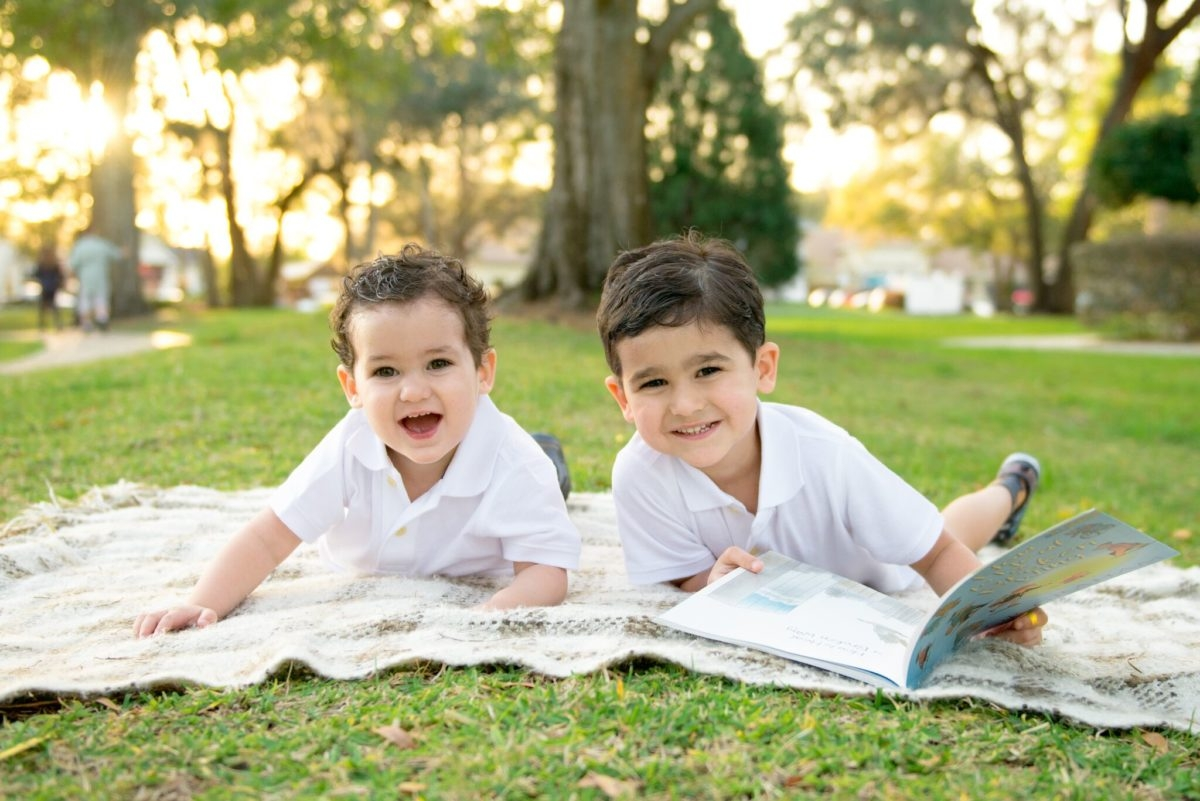 brothers reading outside