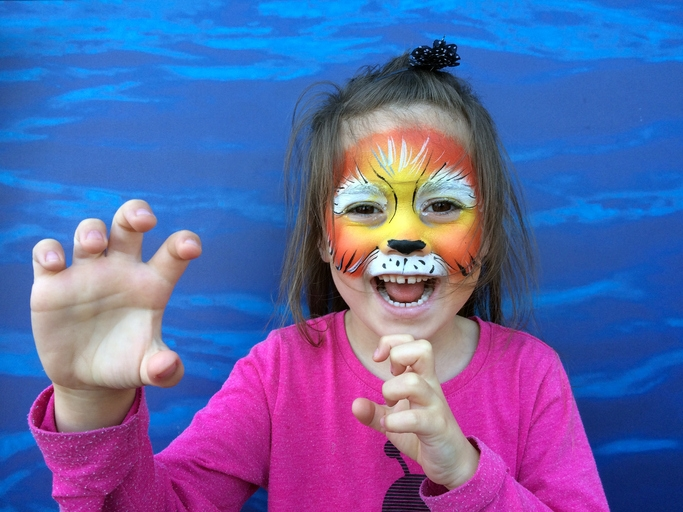 Little child with lion face painting