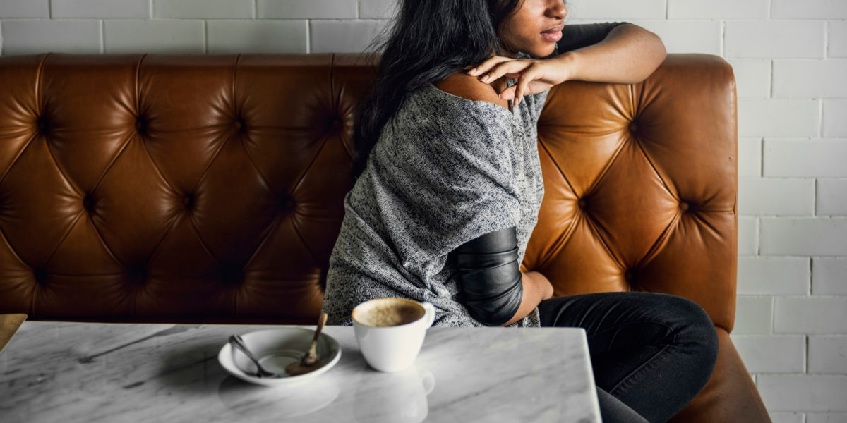 African Woman Drinks Coffee Shop Lonely Concept