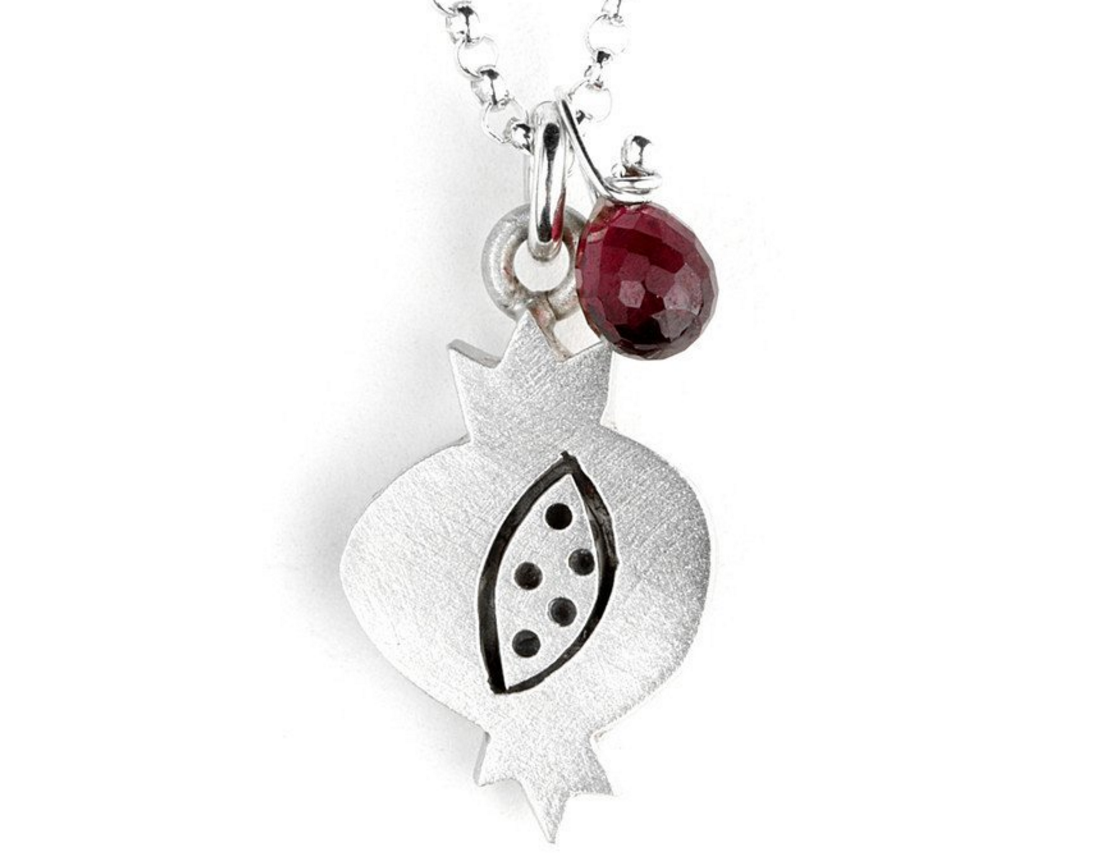 https://moderntribe.com/collections/shop-by-holiday_rosh-hashanah/products/naive-pomegranate-combination-necklace