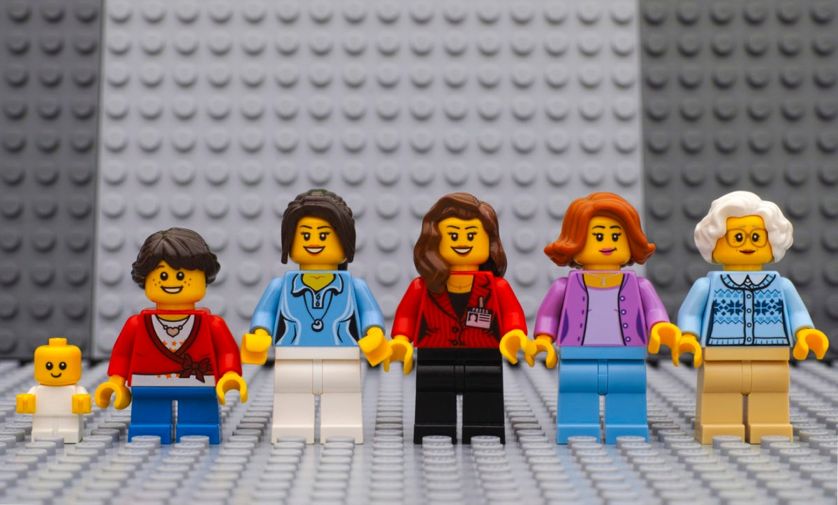 Six Lego woman minifigures of different age