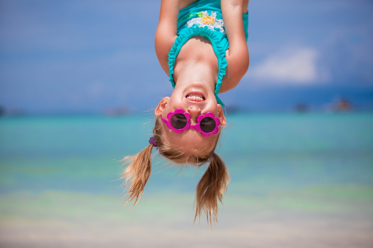 Happy girl outdoors during summer vacation have fun with father