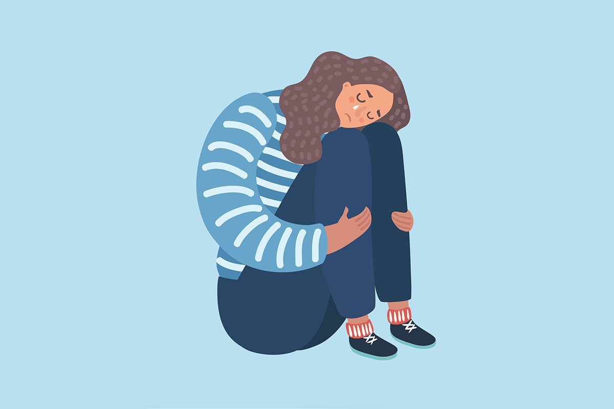 Sad woman on light blue background