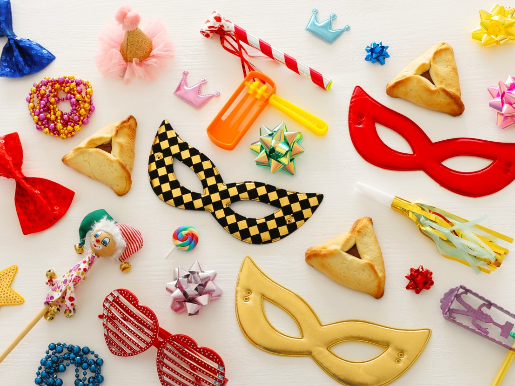 purim-celebration-concept-over-wooden-white-background-picture-id1129386838