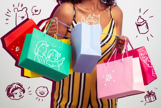 Be excited by new goodies! Happy shopper woman looking inside shopping bags.