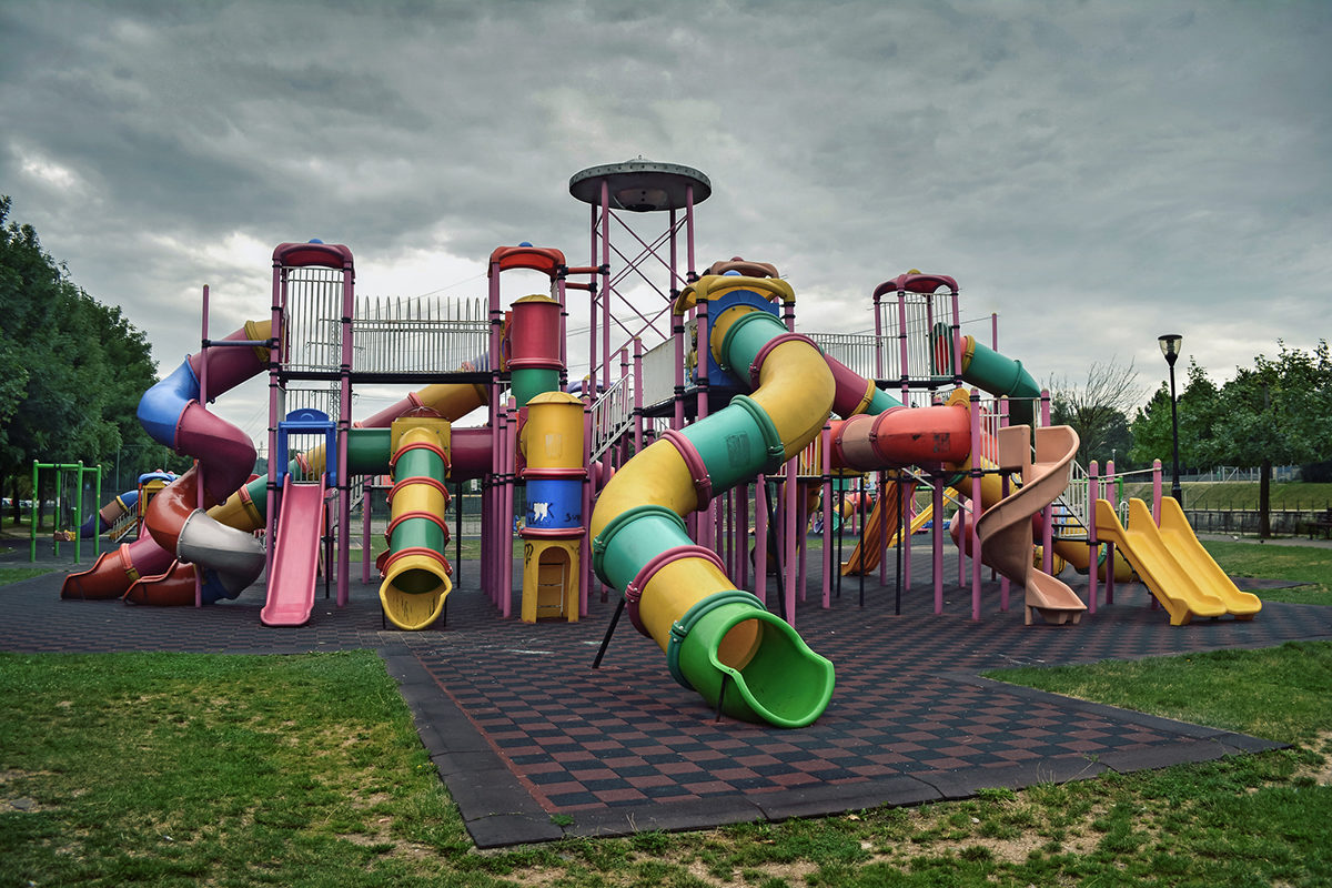 Slides On Playground Against Cloudy Sky At Park
