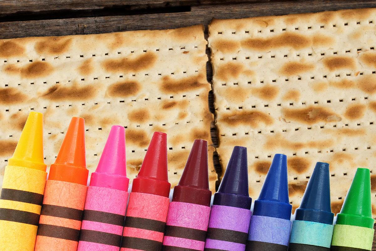 Multicolored crayons on matzah