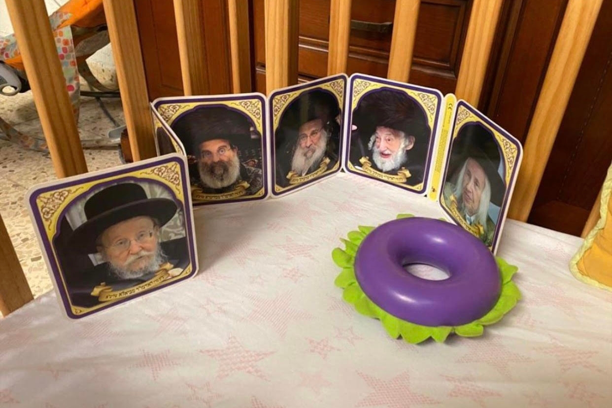 board book with rabbis in a crib