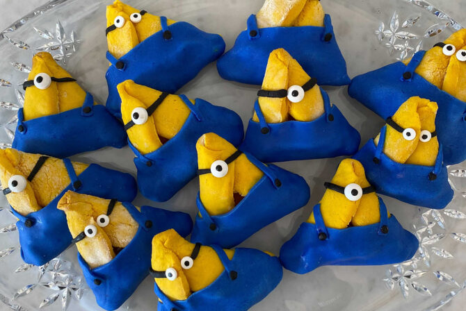 a plate full of hamantaschen that look like minions