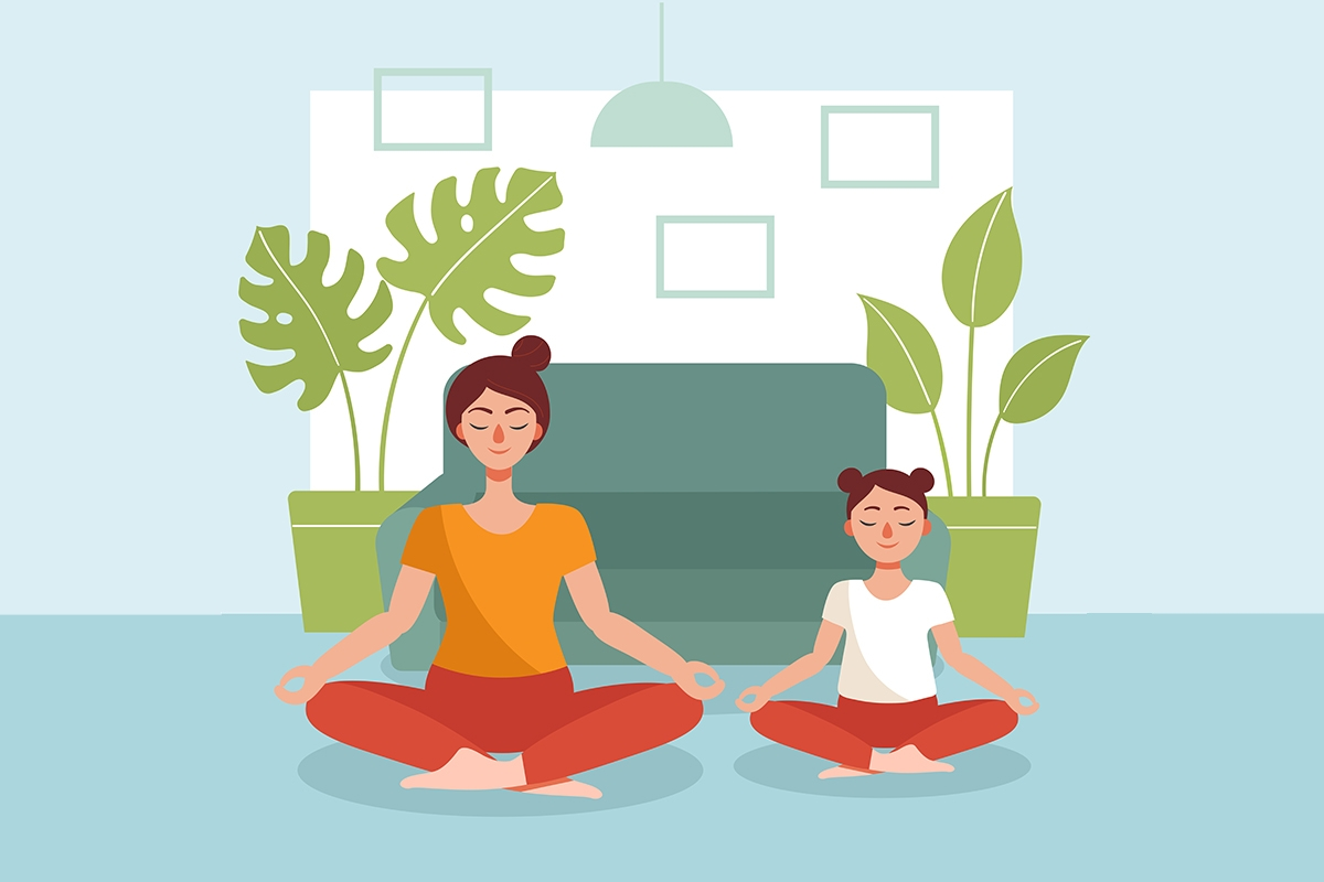 A mom and daughter sit cross legged on yoga mats with their eyes closed.