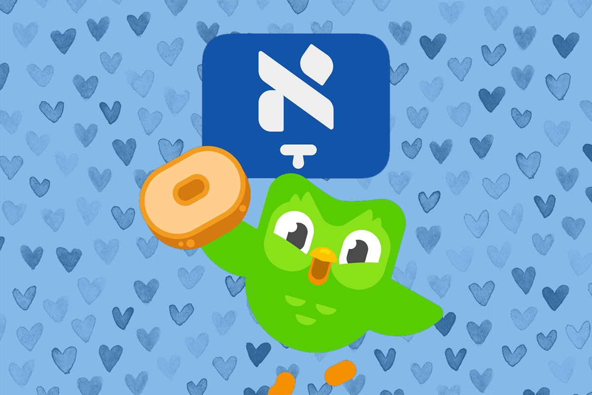 Duolingo owl flying near a bagel and a Yiddish letter, with a blue heart background.