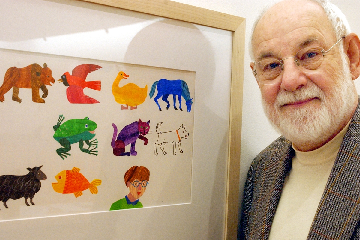 """AMHERST, MA - NOVEMBER 13: Artist Eric Carle, an illustrator and author of children's books, with his work from the book, """"The Mixed Up Chameleon."""" Carle was instrumental in the planning and building of the museum. (Photo by Matthew J. Lee/The Boston Globe via Getty Images)"""
