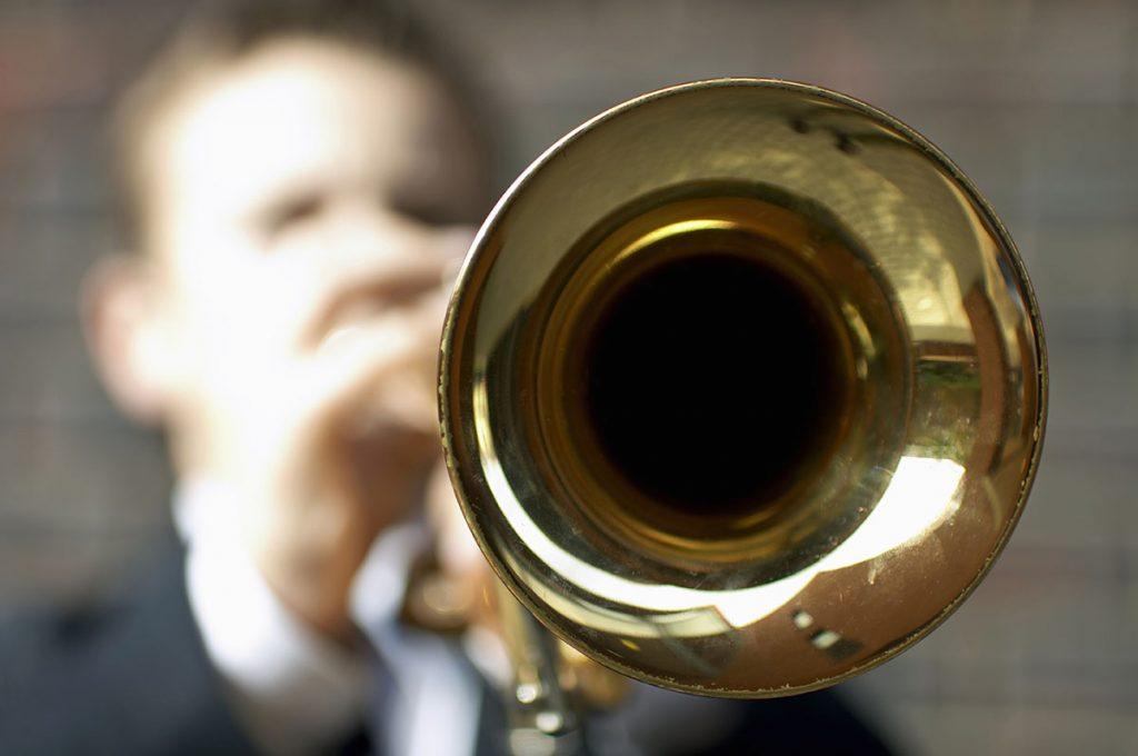 Boy playing trumpet.
