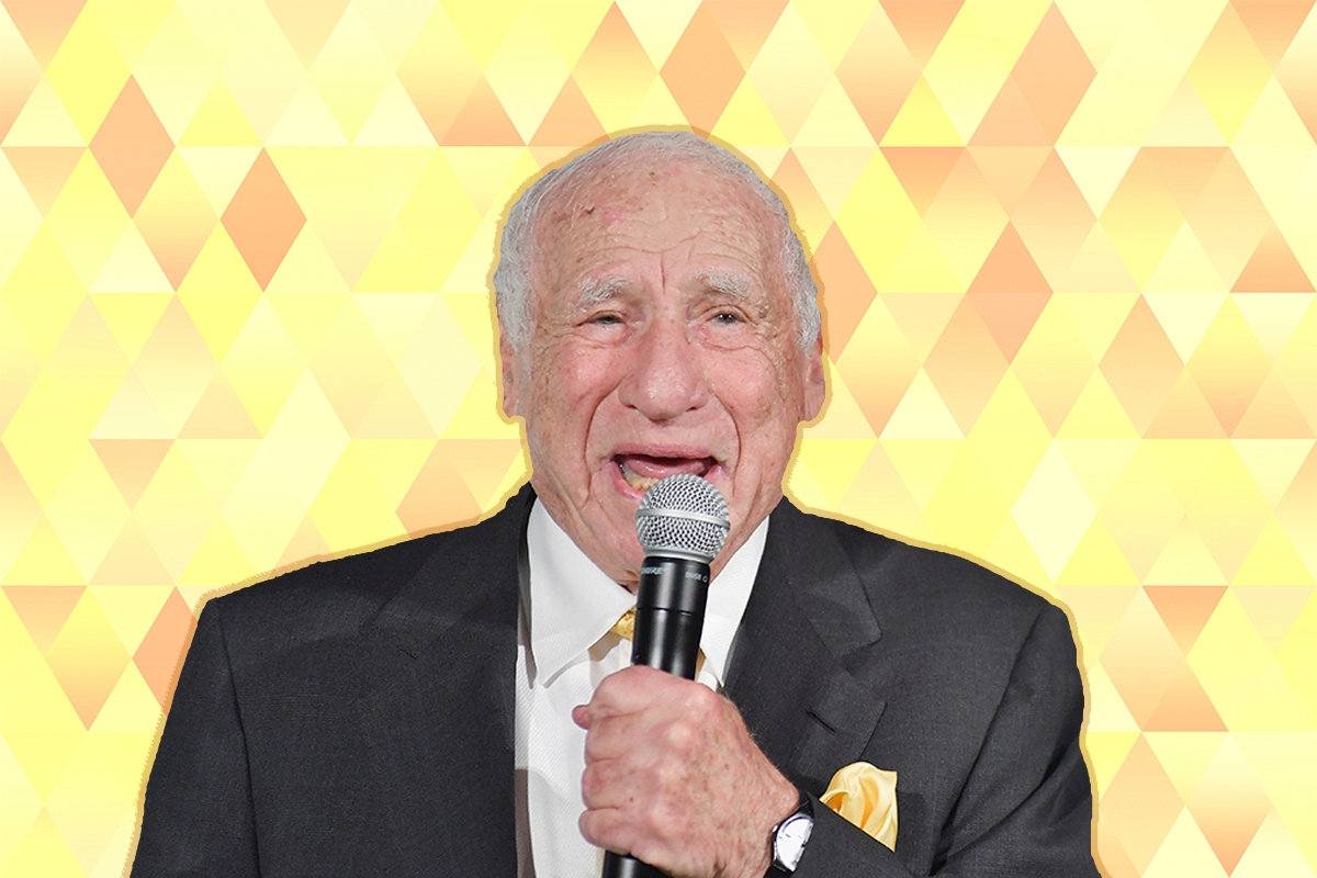 Mel Brooks speaking into a microphone.