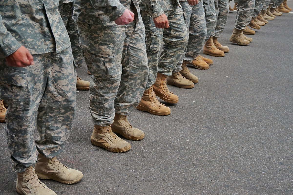 soldiers lined up, uniforms and boots.