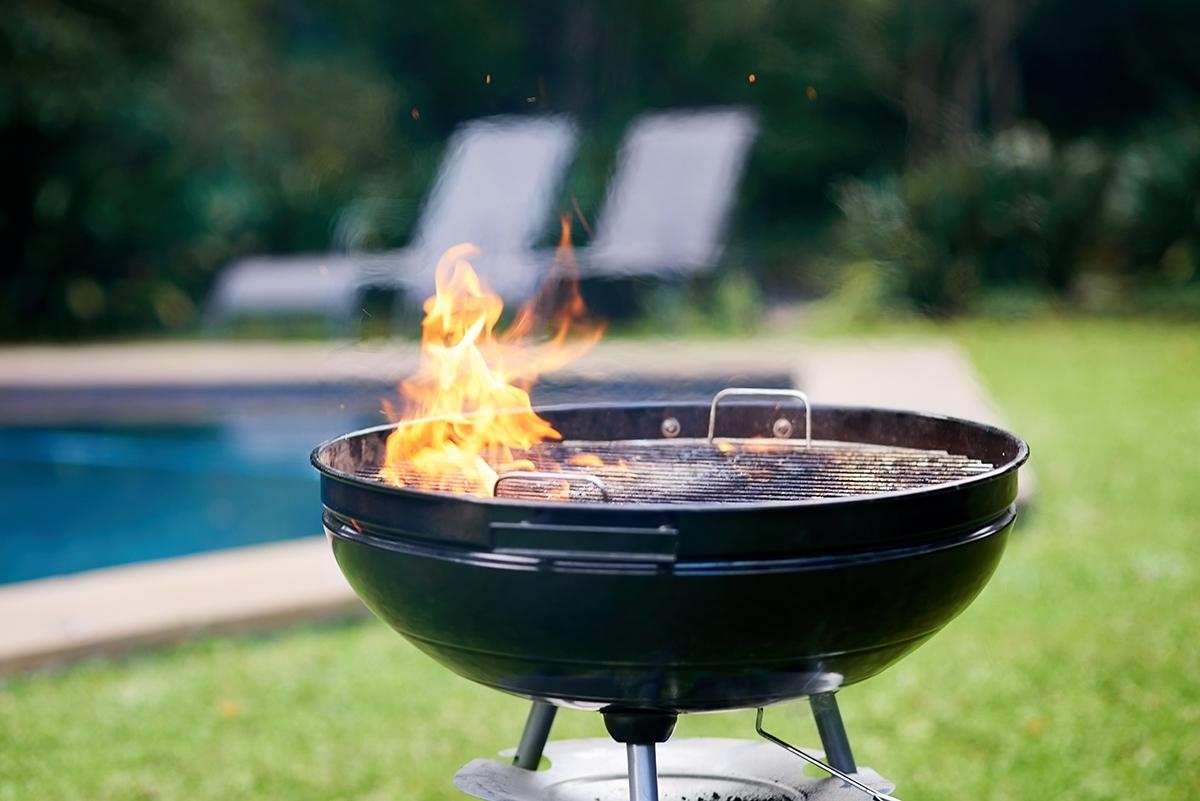 a lit bbq grill