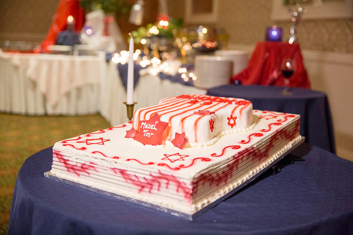 Bar mitzvah cake with one candle and Jewisj decorations