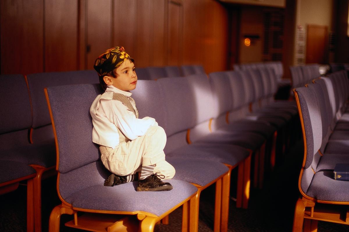 Boy Sitting in a Jewish Temple